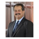 Dow Chemical's Liveris blasts political debate, cuts to R&D